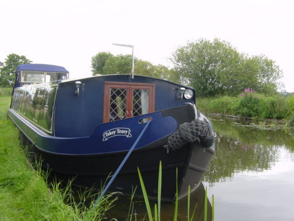 Liveaboard wide beam Takey Tezey on a canalside mooring