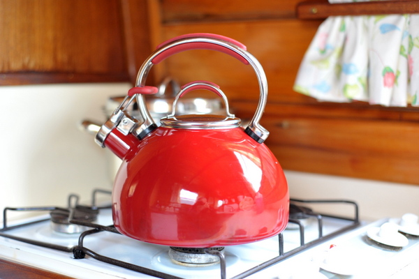 A shiny red narrowboat kettle