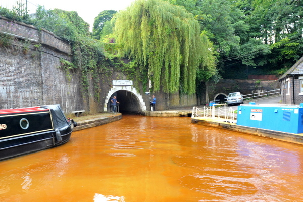 The orange water of Harecastle tunnel's north entrance