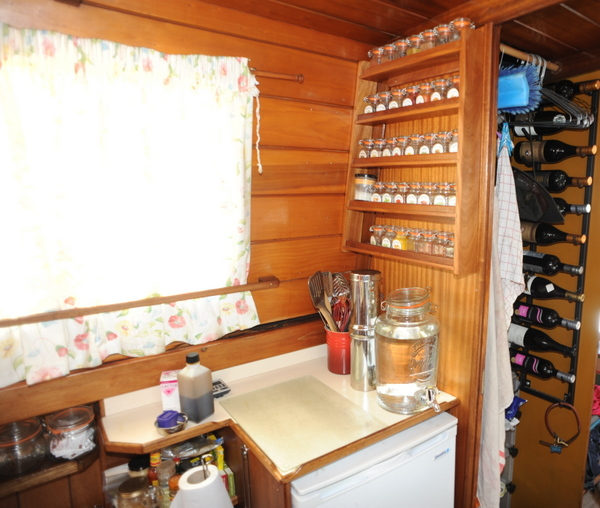 We've used the bulkhead space above the fridge for Cynthia's spices