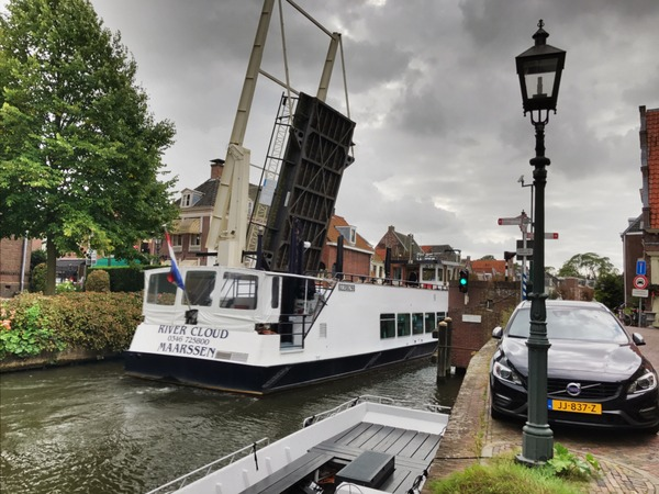 A trip boat squeezes through a narrow bridge at Maarssen