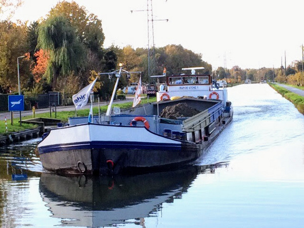 A commercial barge on the Kempesch canal near our mooring