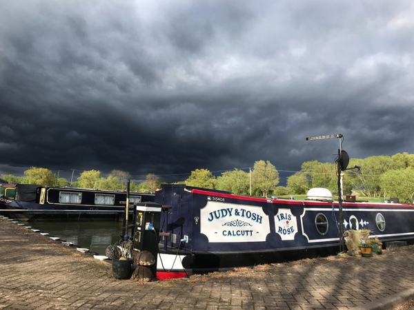 A spring storm sweeps over Calcutt Boats