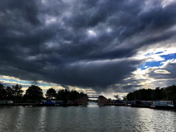 Rain clouds sweep over Meadows marina