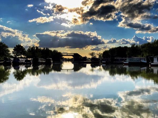 Reflections on a still marina at Calcutt Boats