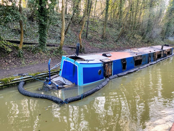 A sunken narrowboat near Braunston tunnel's eastern portal