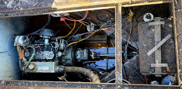 An engine bay filled with water and rust