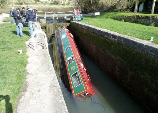 Narrowboat hung up in lock