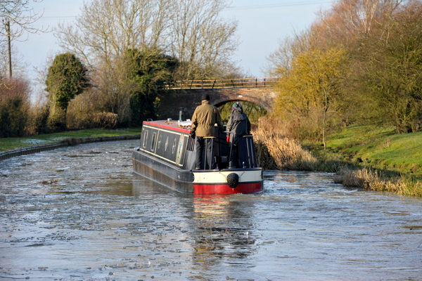 A narrowboat on the icy canal north of Yelvertoft
