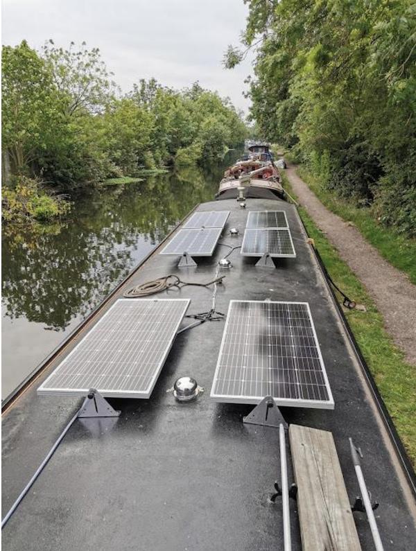Six solar panels on a wide beam