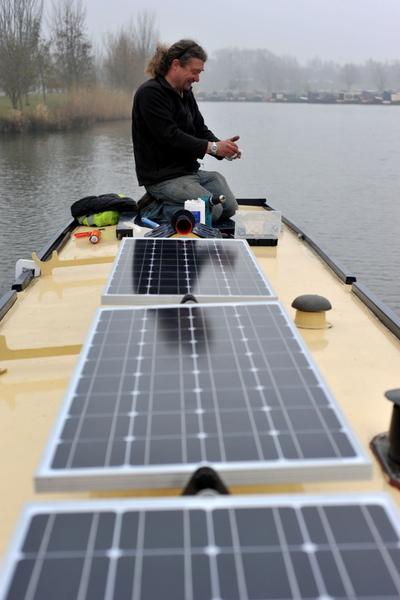 Tim David fitting solar panels on James No 194