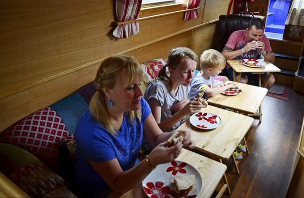 narrowboat family eating meal